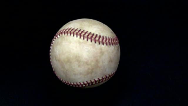 dropping baseball - slow motion - baseball ball stock videos and b-roll footage
