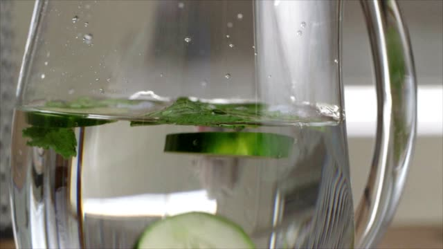Dropping cucumbers into water