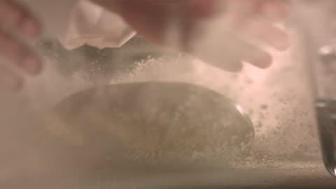 dropping dough on flour on kitchen top. - baka bildbanksvideor och videomaterial från bakom kulisserna