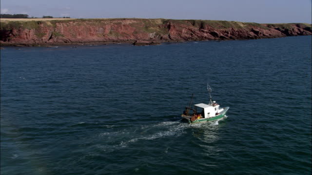 Dropping Lobster Pots Off Arbroath  - Aerial View - Scotland, Angus, United Kingdom