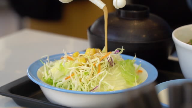 dropping salad cream sauce on the vegetable salad. - salad dressing stock videos & royalty-free footage