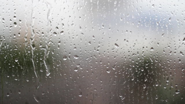 Drops dripping at window