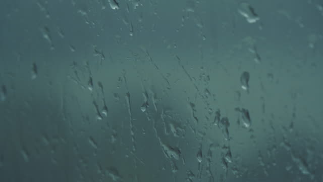 drops dripping down the glass - light natural phenomenon stock videos & royalty-free footage