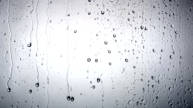 hd: drops dripping down the glass - raindrop stock videos & royalty-free footage