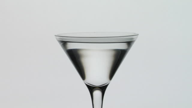 ms, drops falling into martini glass - martini glass stock videos and b-roll footage
