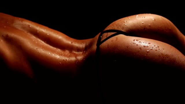 Drops of water on sexy female athletic body