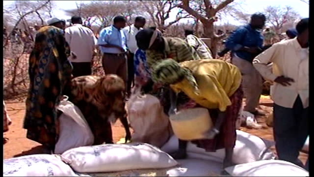United Nations warns more food aid needed as drought worsens AFRICA Kenya El Wak EXT Children desperately grabbing food provided by United Nation's...