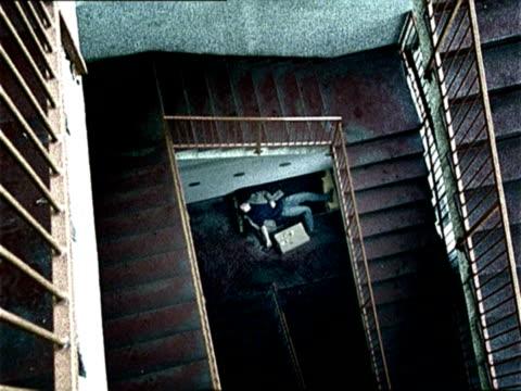 ha, ws, drug addict lying on bed under staircase, ljubjana, slovenia - addict stock videos & royalty-free footage