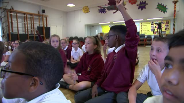 drug arrests on school premises double in five years; england: london: int various of primary school children sat in school hall being taught about... - crime or recreational drug or prison or legal trial stock videos & royalty-free footage