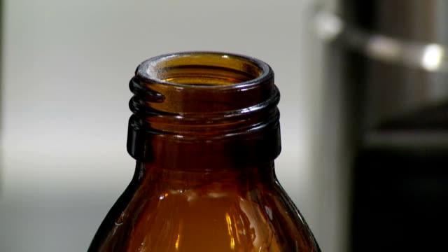 drug, cap, bottle - bottle cap stock videos & royalty-free footage