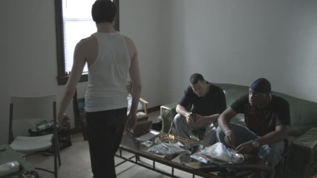 ms, drug dealers arguing while bagging drugs on coffee table, staten island, new york city, new york state, usa - trafficking stock videos and b-roll footage