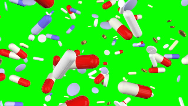 drug falling loopable green screen - pill stock videos & royalty-free footage