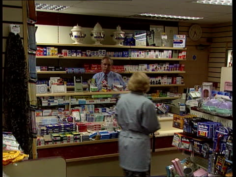 england london cms mark webster i/c sot manchester seq pharmacist james helgason serving woman in shop james helgason intvw sot seriously effect... - itv news at ten stock-videos und b-roll-filmmaterial