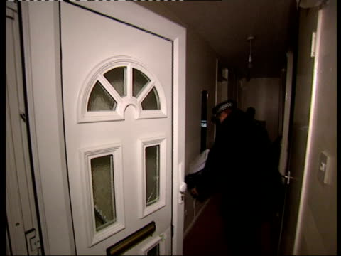 vídeos de stock, filmes e b-roll de u'lay itn england london special police squad raiding home track forward as thru front door - itv london tonight