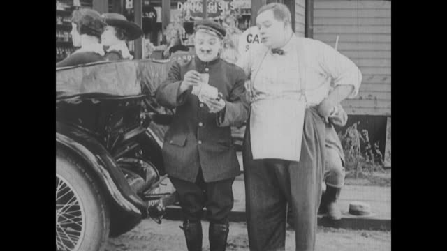 1917 a drug store clerk (fatty arbuckle) increase gas price when a luxury car pulls up to the pump - fuel pump stock videos & royalty-free footage