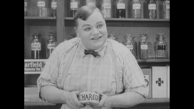 1917 a drug store clerk (fatty arbuckle) offends a customer - sales occupation stock videos and b-roll footage