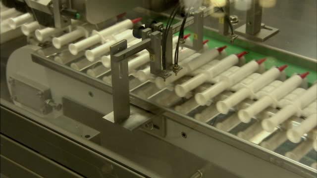 cu pan drug syringes on assembly line, boxmeer, netherlands - boxmeer stock videos & royalty-free footage