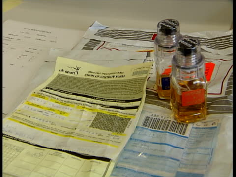 urine sample processed england london king's college int urine samples to be tested fro drugs removed from transportation packaging processed and... - bottle cap stock videos & royalty-free footage
