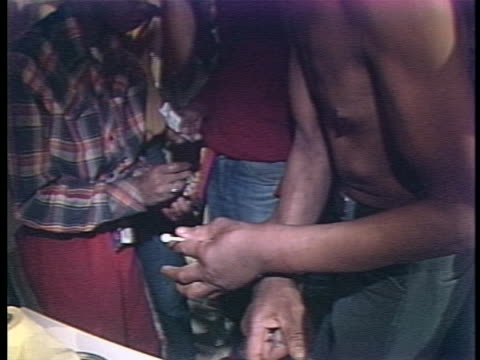 stockvideo's en b-roll-footage met drug users injecting themselves with speed. there is an opening closeup shot of a person injecting drugs into another person's upper arm. there is a... - crime or recreational drug or prison or legal trial