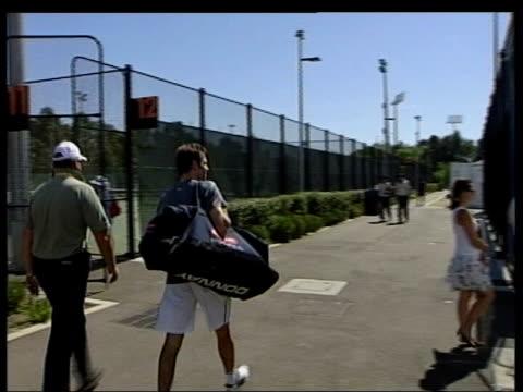 Drugs Crisis LIB Greg Rusedski along to training courts LIB Rusedski training Line being painted on tennis court