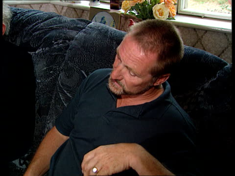 Essex Paul Betts seated on sofa talking reading in meeting with others