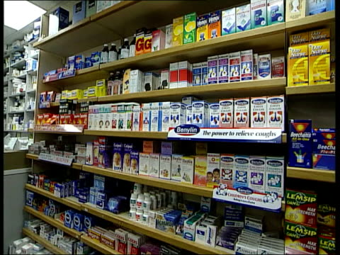 stockvideo's en b-roll-footage met drugs prices may fall after ruling itn london medicines on display on shelves in chemists shop cs aspro clear painkiller cs redoxon vitamin tablets... - shelf