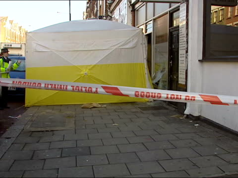 vídeos de stock, filmes e b-roll de heroin gang leader sentenced to 22 years in jail tx haringey ext police forensic tent erected outside kebab shop after gun battle between kurdish and... - curdo