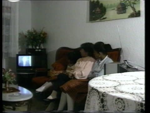 drugs war; itn colombia: bogota: int family group watching president george bush address on drugs on tv cms bush on tv and supers 'national drug... - bericht film und fernsehen stock-videos und b-roll-filmmaterial