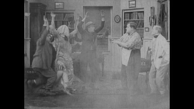 1917 a drugstore clerk (fatty arbuckle) interrupts a forced wedding with gunfire - pastor stock videos & royalty-free footage