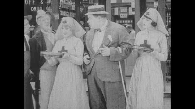 stockvideo's en b-roll-footage met a drugstore clerk (fatty arbuckle) results to questionable behavior when taken by an attractive charity worker - schenking