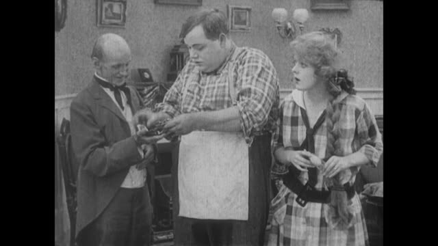 1917 a drugstore clerk (fatty arbuckle) uses chloroform to avoid paying for services - fatty arbuckle stock videos and b-roll footage