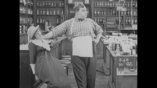 1917 a drugstore clerk (fatty arbuckle) uses chloroform to molest an unconscious woman - fatty arbuckle stock videos and b-roll footage