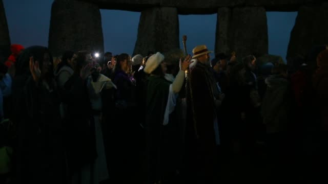 druids pagans and revelers gather in the center of stonehenge hoping to see the sun rise as they take part in a winter solstice ceremony at the... - paganism stock videos and b-roll footage