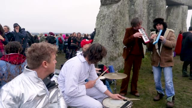 druids, pagans and revelers gather in the center of stonehenge, hoping to see the sun rise, as they take part in a winter solstice ceremony at the... - prehistoric era stock videos & royalty-free footage