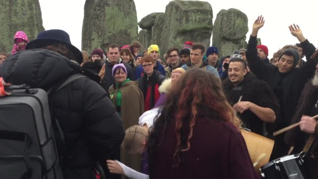 druids, pagans and revellers gather in the centre of stonehenge, hoping to see the sun rise, as they take part in a winter solstice ceremony at the... - prehistoric era stock videos & royalty-free footage