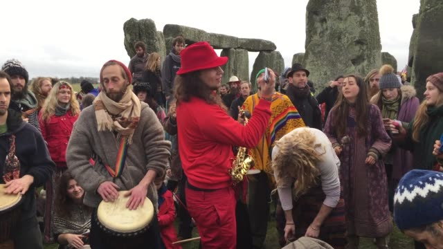 druids pagans and revellers gather in the centre of stonehenge hoping to see the sun rise as they take part in a winter solstice ceremony at the... - paganism stock videos and b-roll footage