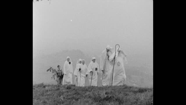 druids walking up to glastonbury tor for pagan may day ceremony - spirituality stock videos & royalty-free footage