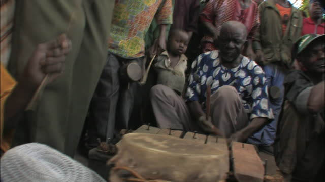 a drum band performs traditional music in mozambique. - musician stock videos & royalty-free footage