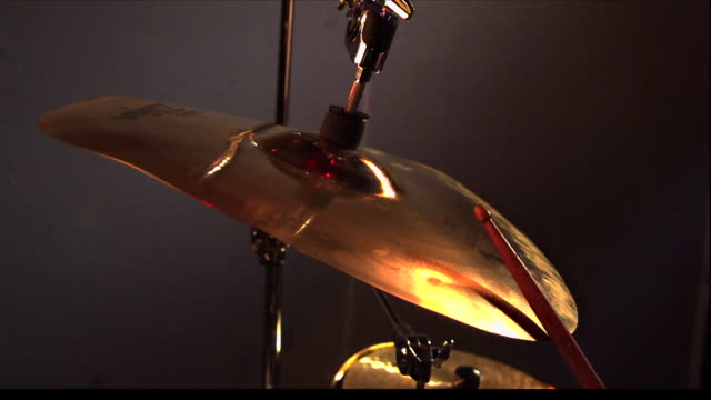 a drum stick hits a cymbal. - sound wave stock videos & royalty-free footage