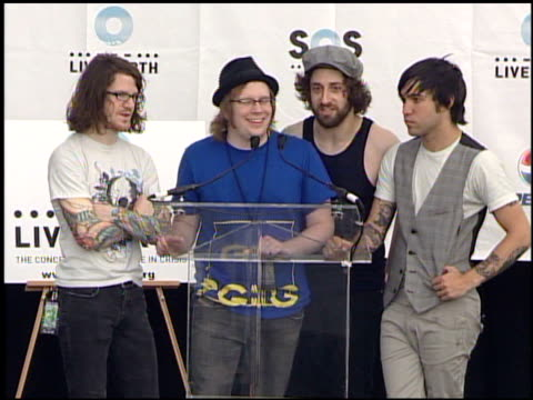 Drummer Andy Hurley singer and guitarist Patrick Stump guitarist Joe Trohman and bassist and singer Pete Wentz of Fall Out Boy at the Live Earth New...