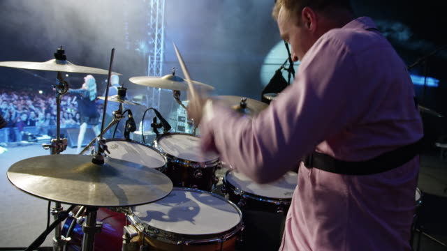 drummer playing drums in night concert - drummer stock videos & royalty-free footage