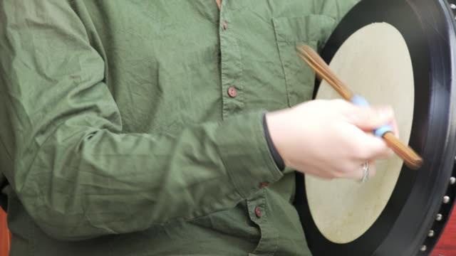 Drummer Playing Irish Bodhran Close-up (4k/UHD)