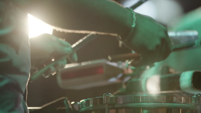 Drummer plays drums, slow motion close up