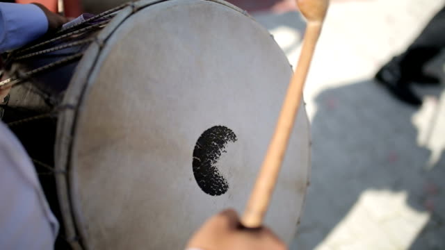 drummer plays local drum instrument on the street - street performer stock videos and b-roll footage