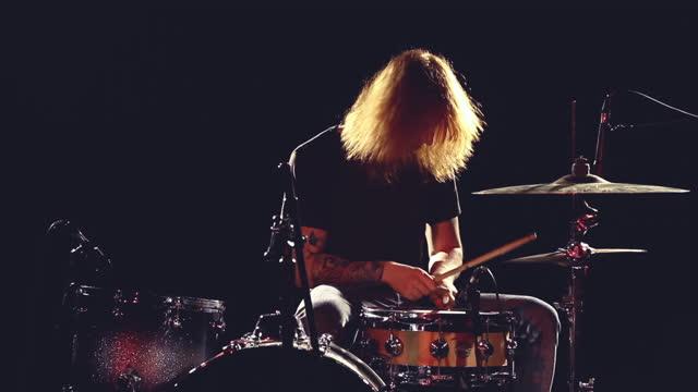 drummer plays on a dark stage on june 01 2021, in bristol, united kingdom. - rock stock videos & royalty-free footage