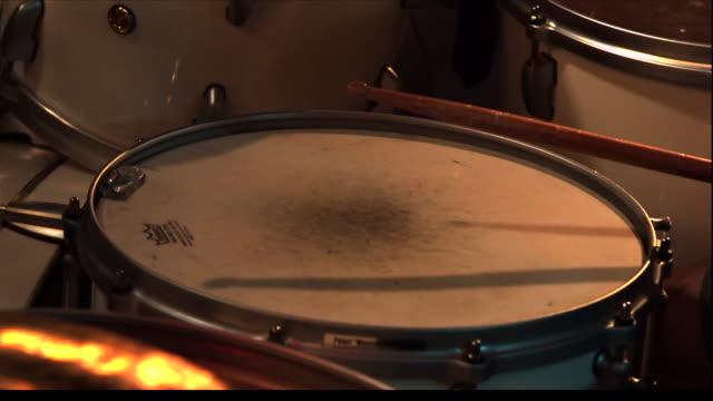 a drummer taps a drum. - trommel stock-videos und b-roll-filmmaterial