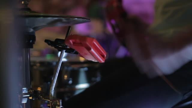Drummer Using a Tambourine