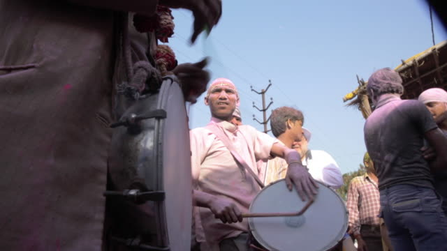 drummers at holi festival, india - rhythm stock videos and b-roll footage