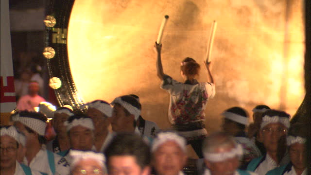 Drummers beat a drum on a parade float at the Nebuta Festival in Japan.