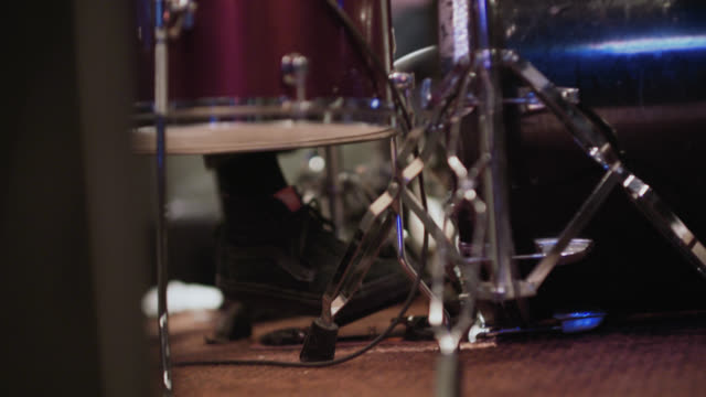 drummer's feet hammer on the kick drum pedal on stage at rock concert - drummer stock videos & royalty-free footage